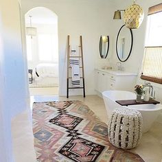 The bathroom is not the most traditional place for a rug but I love this beautiful bathroom by @beckiowens. #bathroomgoals  #turkishrug #vintagerug #modernbohemian