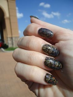 dragon scale nails - black base, with drops of fine glitter on top