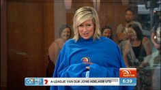 Mel models the exclusive Sunrise Snuggie!