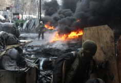 Tires burn amid Kiev clashes. (Sergei Chuzavkov/AP)