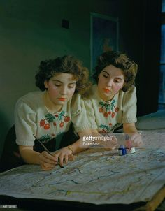Twins Rita and Irene Day at work in the map section of the Ministry of Town and Country Planning, December 1944.