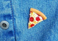 This baby pizza slice was handmade using polymer clay. The toppings include cheese, pepperoni slices and some pepper flakes. Finally, I gave the