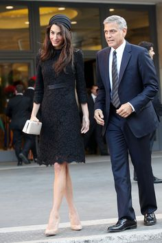 Amal Clooney looked elegant in a black Atelier Versace lace dress and silk hat with husband George Clooney for their meeting with Pope Francis at the Vatican.