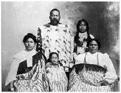 A Taranaki Family.Te Whare-aitu and his wife and children (Ngati-Tupaea hapu of Ngati-Ruanui tribe)