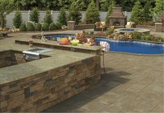 Complete your backyard with a fireplace! Your whole family will enjoy it after a day spent in the pool!