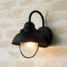 Above: The 12-inch-high Nantucket Wall Light is available in three finishes; $99 at Shades of Light.