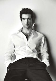 Ethan Peck dons a classic white dress shirt with trousers for his Maxim photo shoot.