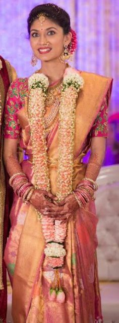 South Indian bride. Hindu bride. Tamil bride. Telugu bride. Malayalee bride. Pink silk kanchipuram sari. Fresh flower garland. Pranitha Reddy Manoj Manchu engagement.