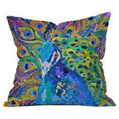 Throw pillow with a peacock motif by artist Elizabeth St Hilaire Nelson from DENY Designs. Made in the USA.   Product: PillowConstruction Material: Polyester coverColor: MultiFeatures: Designed by Elizabeth St Hilaire Nelson for DENY Designs Concealed zipperInsert included Dimensions: 18 x 18 Cleaning and Care: Spot treat with mild detergent