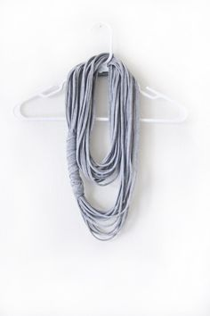 Make a cool multi-strand scarf out of your ex's t-shirt. | 26 Easy Style Hacks To Turn An Old Tee Into A Head-Turner