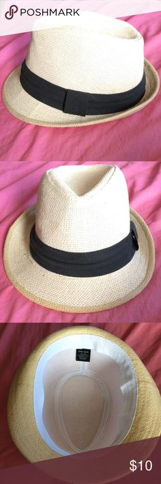 Black and white Fedora Hat 100% paper material with a white cloth lining. Worn once and never used after. Bought at Wet Seal. Wet Seal Accessories Hats