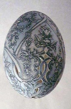 SWAN EGG ART - A Hungarian artist , Csuhaj Tunde was born in 1954, she graduated studies in ceramics at the University of the Arts , Pecs, Hungary. Since 1990, she has decorated geese, swan, emu, rhea and ostrich eggs and has produced astonishing Easter eggs. Her techniques are mainly etching, drilling and painting.