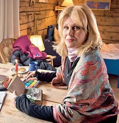 Joanna relaxing with her sketchbook in the fisherman's cabin on the Lofoten Islands where she stayed