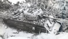 An M4A2 stuck in the mud. Note the added tracks and wooden panels for extra protection and the nails welded on the turret hatch to keep the Japs off.