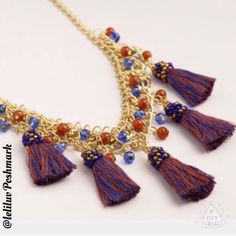 Tassel & bead necklace in purple/gold NWT, handcrafted of metal with gold finish, glass and cotton thread. 💠Chain extender with lobster clasp closure features a cute blue bead at the end of extender. 💠Features 5 large fringe tassels in purple and dark blue hues, wrapped in small bronze and blue beads. 💠Thickest part of chain features blue and amber colored beads.💠  🚫No trades🚭Smoke-free 🐶Pet-friendly 🌺🌹Thanks for shopping @leliluv! Jewelry Necklaces