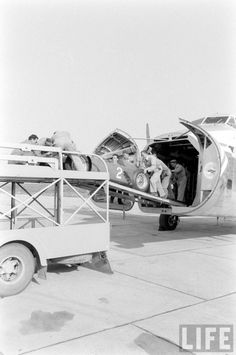 A great shot showing Scuderia Ferrari racing team unloading the D50 race cars from the cargo plane onto the transport trucks upon returning from the 1956 BRDC International Trophy of Silverstone. D50 #2, ch.number 0001, is raced by Peter Collins. They are headed with the d50′s to Ferrari's facilities where technicians will in prepare them for the 1956 Monaco Grand Prix. — Photo by Thomas McAvoy for LIFE magazine.