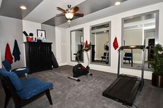 ceiling fan, hooks & mirrors in gym