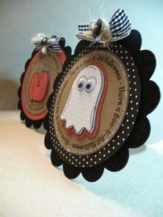 Ghost and pumpkin tags--can add those mini wood shapes to the fronts to make any theme....love this idea!!! :-)