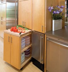 Solution for kitchens with not enough space for an island- a rolling cabinet that stows away & still has storage!