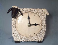 Ceramic sheep clock. Handbuilt with white clay. Covered with glazes. Electric high-fired at 1060 C degree. Height: 14 cm. (about 5,5). All of my
