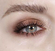 brown smokey eye with gold glitter + brushed up brows | makeup idea