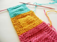 Pretty pastel-colored squares.  This is a great way for beginner #knitters to practice their new skills!