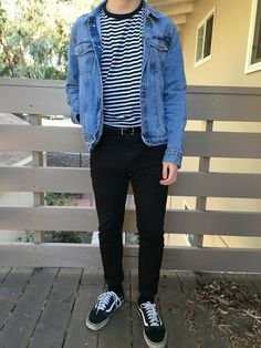 Blue jeans jacket, striped tee, black jeans with leather belt and old school Vans.