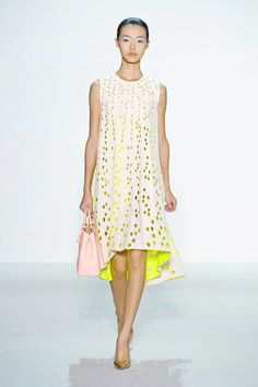 Christian Dior's Spring 2013 runway was a master class in neon mash-ups, as designer Raf Simons accented a perforated white gown with an acid yellow underskirt.  Follow model Tian Yi's lead: If you're wearing a shade last seen on a Lisa Frank sticker book, pair it with light-colored neutrals like ivory, peach, or even lilac. The contrast between neon and neutral looks fresh and modern—and nobody will accuse you of heading to a Go-Go's concert after work.