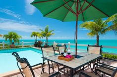 A photograph of the pool deck and unobstructed view at Villa Sunset Point, Providenciales (Provo), Turks and Caicos Islands, BWI. Vacation Home Rentals, Vacation Villas, Vacation Trips, Turks And Caicos Villas, Turks And Caicos Vacation, Sunset Point, Luxury Villa Rentals, Caribbean Vacations, Private Pool