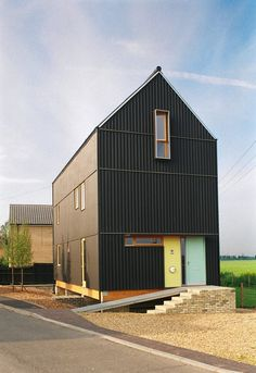 fibre cement corrugated cladding, painted black - reference to traditional local barns - The Black House - Ely, Cambridgeshire, UK - Mole Architects - 2003