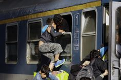 Migrants of several countries enter a local train going to the Hungarian-Austrian border at Keleti (East) railway station in Budapest© 2015 AFP Budapest, Countries, News, Google, The Journey, Dreams, Syrian Refugees, Train, Country