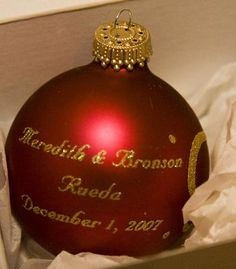 Great idea for winter wedding favors: red & gold Christmas ornaments for the tree so your guests can always remember your special wedding! | photo by: Allegro Photography