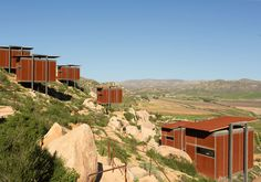 Valle de Guadalupe, Mexico  Where To Stay: The Encuentro Guadalupe Looking for a unique, modern stay in Mexico? The Encuentro Guadalupe is the way to go. The hotel houses sleek pods on a low mountain, overlooking a rolling wine valley. It also features an infinity pool and a glass villa if you're looking to take things up a notch.