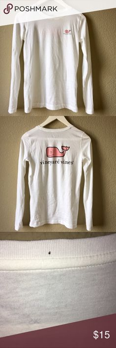 Vineyard Vines long sleeve shirt Super soft Vineyard Vines white long sleeve shirt with pink whale on left chest and back. Worn probably twice and has no stains, but ****please note, there are 3 small holes on the back neckline. One hole goes all the way through (see 3rd and 4th pictures). My hair covered the hole when I wore my hair down. Vineyard Vines Tops Tees - Long Sleeve