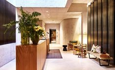 A apartment house in Basel has been carefully renovated by Buchner Bründler Architecten with the interior design by Grego and furniture by This Weber and Very Wood. Nomad Hotel, Public Hotel, Lobby Lounge, Interior Decorating, Interior Design, Small Sofa, First Apartment, Hospitality Design, House Front