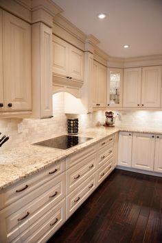 New Giallo ornamental Granite with White Cabinets