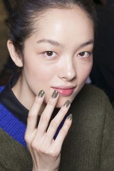 Army green nails with a touch of gold