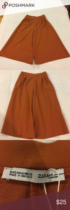 Zara burnt orange gaucho style pants Burnt orange gaucho style pants from Zara. Worn once but still in good condition. Size: S Zara Pants Trousers