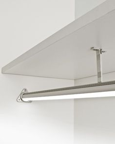 Illuminated LED closet rod works on a motion sensor so you don't have to switch on the closet light to find your clothes