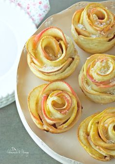 Overhead shot of the apple roses on a cake stand.