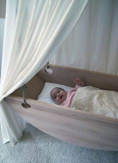 This bassinet turns into a sail boat after baby has out grown the space - interesting.