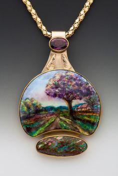 "Karin Pohl- Purple Tree Scene Pendant - Various Enamels - Opaque, Opalescent, Transparent - w/ Foils. Hand Fabricated Setting: 14k & 22k YG; Boulder Opal, 6 x 8mm Faceted Sri Lanka Spinel. Size: 2"" x 1 1/4""."