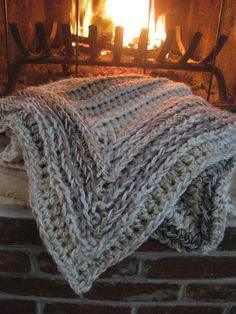 Crochet  blanket in creams and browns, crochet throw, oatmeal crochet blanket, plush crochet throw. $150.00, via Etsy.