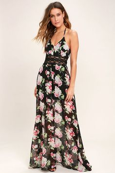 We've come to a decision, the Natural Conclusion Black Floral Print Maxi Dress is our new fave! Lightweight poly, with a red, pink, and green floral print, flows from skinny straps into a princess seamed, triangle bodice. Pierced crochet lace, tops a full maxi skirt. Adjustable T-back.