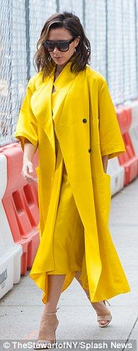 Minimalist: The 43-year-old designer - likely wearing her own collection - rocked a bright...