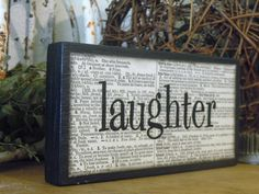 Laughter Wooden Block - blocks are hand cut, painted and decorated with old book pages then stamped and embossed, then sealed with a top coat.