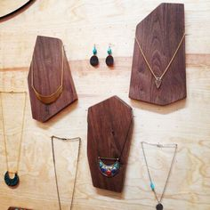 Geo shaped wood blocks for jewelry display at a craft fair.