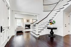 Vince Vaughn's grand foyer with large white staircase