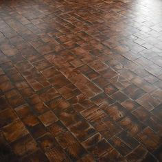 This log end wood tile floor is installed near Windsor, Ontario. The species include white oak and red maple.  The sizes range from 4x4's to 6x6's, and the floor has been mildly stained.  Reminiscent of old cobble stone roads in Montreal, Quebec city, and Boston Massachusetts, This type of floor as mild texture and is full of character.  Click on the picture for product specifications.  Ref. no. 740