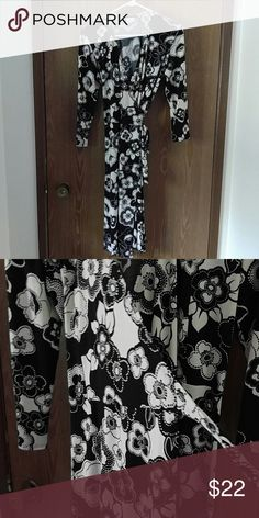 Black and off-white wrap dress Black and off-white floral wrap dress. Super cute and comfy. Lots of stretch! B. Darlin Dresses